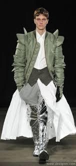 sports wear meets office with knight armor like boots avant garde meets arabic
