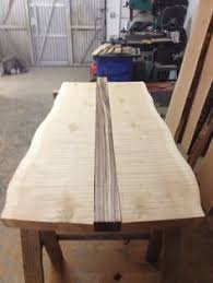 natural edge furniture. alligator juniper sustainably salvaged natural wood slabs waiting to be rescued by artisan and made into an awesome dining table or live edge furniture