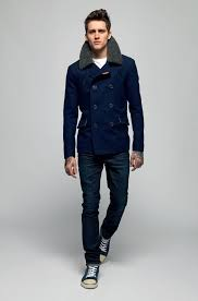 team a dark blue pea coat with navy jeans for a work approved look