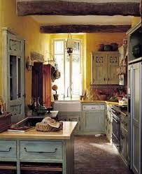 blue rooster motif mark wilkinson french provincial kitchen with yellow walls mfw via atticmag