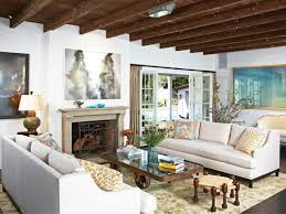 living room decorated with wooden ceiling and stone fireplace beams living h24 beams