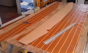 using a razor knife an straight edge to cut the lonseal flooring
