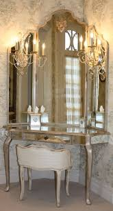 antique makeup vanity with mirror image and candle