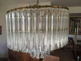 3 tier lucite brass chandelier photo