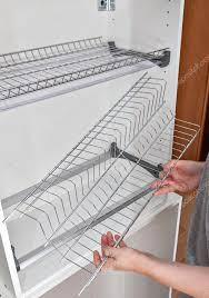 assembly wire dish rack for drying dishes inside kitchen cabinet