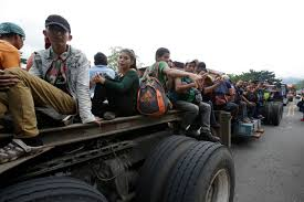 Image result for honduran migrants on truck beds