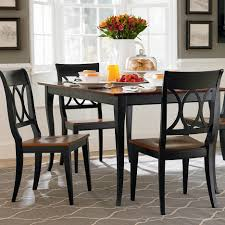 black kitchen dining sets: archaic black color wooden archaic black color wooden dining table with brown top armless black wooden chairs with brown seats diagonal shape grey color plush carpet white flowers vase kitchen dining table furniture furniture x