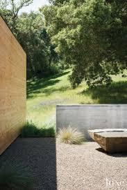 best images about luxe landscapes texas homes modern neutral landscape vignette cedar wall