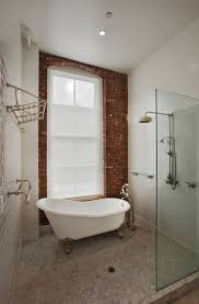 Bathroom:Airy Bathroom With Brick Wall Near Oval White Clawfoot Bathtub And  Round Stainless Shower