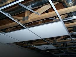 Attractive How To Install Hanging Ceiling Begin Putting Tiles In Place Install Wiring Ceiling  Fan Installing Drop