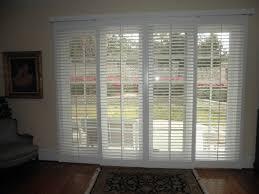 white shutter blind on white stained wooden frame sliding door