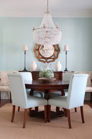 blue dining room and empire chandelier with round table