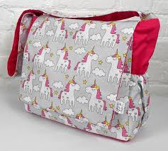 grey unicorn with hot pink accent
