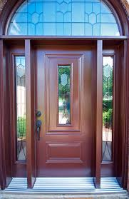 gorgeous chestnut steel entry door with half moon transom and double sidelites