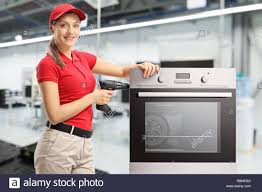 Appliance Repair Woman High Resolution Stock Photography and Images - Alamy