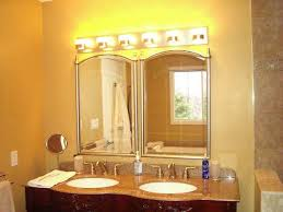bathroom vanity cabinets with double sink and lighting fixtures over mirror above mirror bathroom lighting