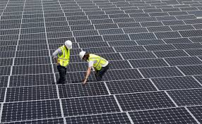 study u s solar growth will more than double this year fortune technicians work on solar panels