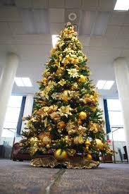 Adorable Christmas Tree Decorating Themes With Gold Glitter Ball F Ribbon  Also Ornaments Decoration Ideas
