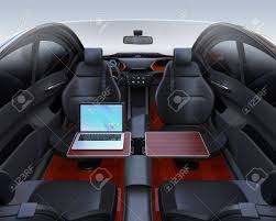 Auto Mobile Office Autonomous Car Interior Front Seats Turned Around And Laptop