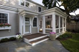 screen porch designs urns decking wood steps stone pavers garden patio upholstered chairs grey walls wood