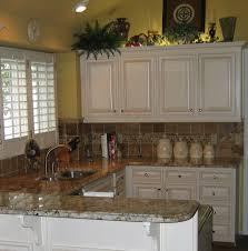 Kitchen Over Cabinet Lighting Reface Maple Biscuit With Glaze Granite Tops Tile Backsplash