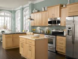 Love this wall color with the Maple cabinets and dark wood floors