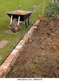 garden edger. Brick Edging Garden Grass Lawn - Stock Image Edger