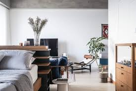 apartment studio furniture. Bed And Decorative Bedside Charlotte Perriand Chest In A Vintage Studio Apartment | NONAGON.style Furniture