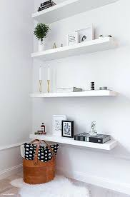 a chic apartment in white floating shelves clutter a chic apartment in lack wall ikea white
