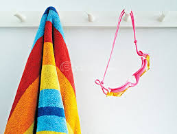 Image Wall Hanging Beach Towel And Goggles Spaces Images Stock Photos Beach Towel And Goggles Stock Photography Online