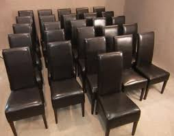faux leather restaurant dining chairs. a large quantity of black faux leather dining chairs; ideal for any restaurant, bistro, cafe etc. the chairs are all in good condition with no loose restaurant