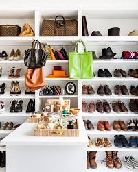 walk in closet with shoe shelves and bag shelves
