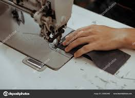 sewing process of the leather wallet mans hands behind sewing leather work