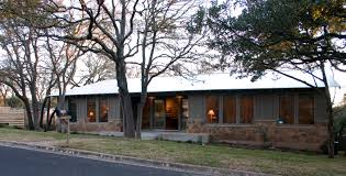 modern ranch style exterior with metal roof and one story design