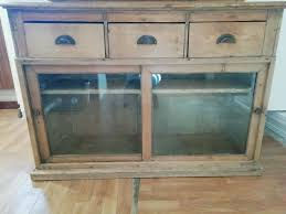 antique wooden sideboard storage cabinet with three drawers and glass sliding doors