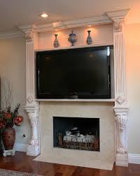 Framed Tv Above Fireplace Fireplace With Tv Above Designs Impressive Fireplace With Tv
