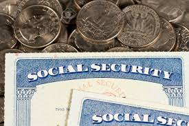 Quarter Cards Usa Social Security Cards Laid On Pile Of Quarter Coins To Illustrate