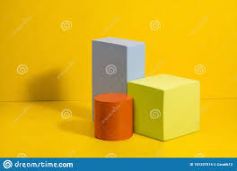 Three Dimensional Solid Shapes On Colored Paper Stock Image
