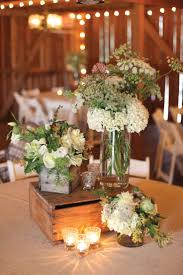 Vintage Gathering Wedding Flowers: 15 Rustic Wedding Centerpieces Photo by  Aaron Snow Photography