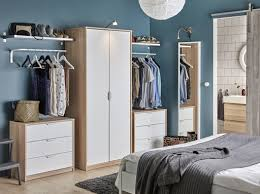 A Bedroom With A Wardrobe In Oak Effect With White Doors Combined With Two  Chest Of