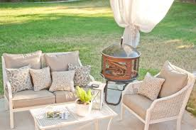 est patio furniture patio furniture brown chair and frame book vase plant cover candle fireplace