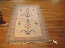 camel and brown tribal geometric afghani rug