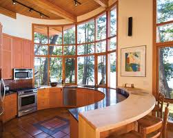 circular kitchen design. example of a trendy u-shaped terra-cotta floor and orange open concept circular kitchen design