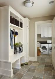 portland maine homes laundry room traditional with stone tile floors contemporary trash cans