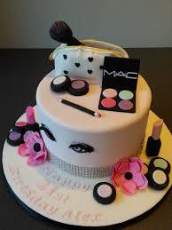 mac cosmetics 21st birthday cake make up bag with pink flowers and hand drawn eyes with false eyelashes