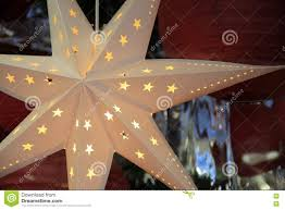 Attaching Christmas Lights Inside Windows Beautiful Detail In Cut Out Star Ornament Hanging In Shop
