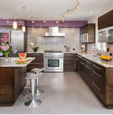 kitchen with modern furniture and led track lighting