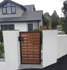 modern style garden gate deep framed in metal with iroko hardwood timber