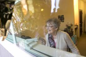 Gathered at her window, family wishes Bernie Coles a happy 100th year