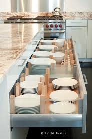 keep plates stacked and sorted in divided drawers